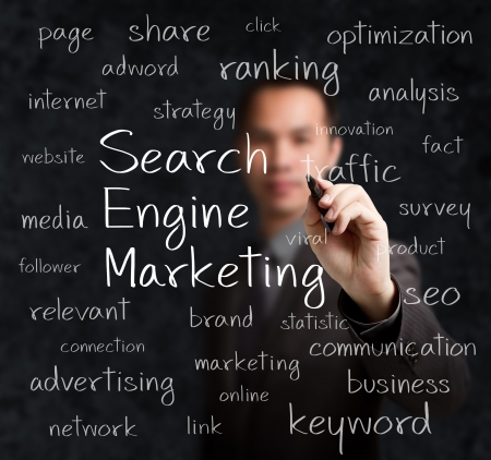 business man writing search engine marketing concept photo
