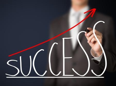 business man writing success graph Standard-Bild