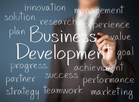 business man writing business development concept