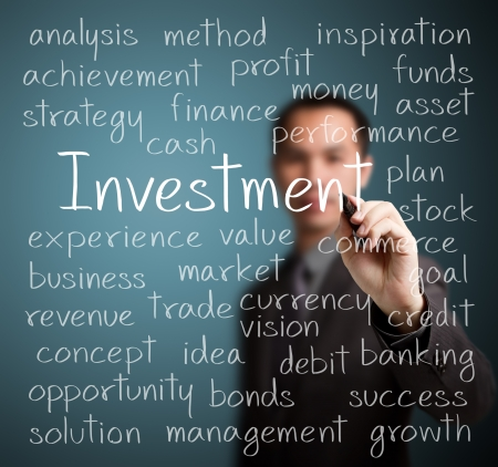 investors: business man writing investment concept Stock Photo