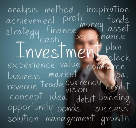 business man writing investment concept Standard-Bild