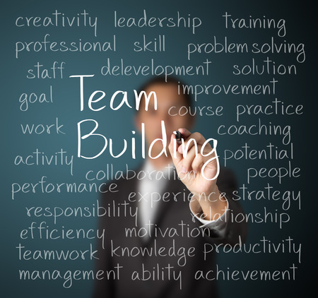 business man writing team building concept