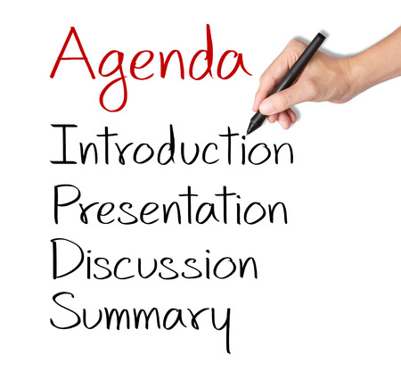 meeting agenda: business hand writing meeting agenda Stock Photo
