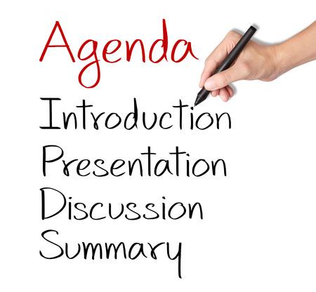 business hand writing meeting agenda Standard-Bild