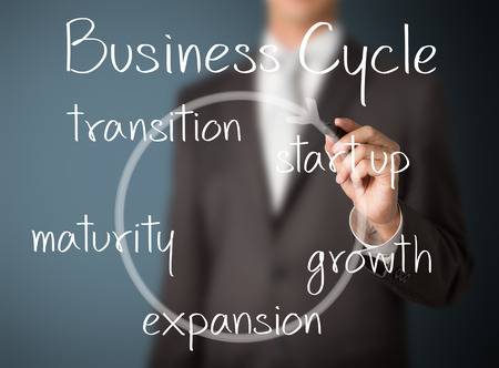 transition: business man writing business cycle Stock Photo