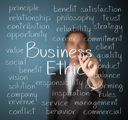 ビジネス倫理の概念を書くビジネス男 写真素材