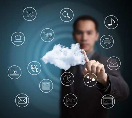 computer cloud: business man pointing at  cloud computing network Stock Photo