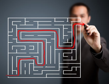 business man solved the maze photo