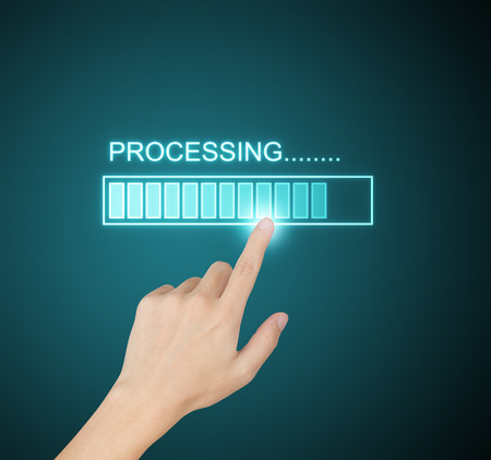 obtain: hand pressing processing progress on screen Stock Photo