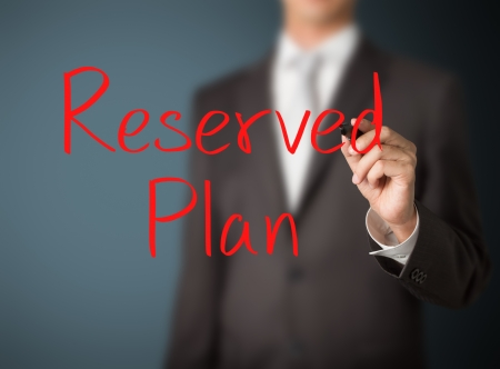 business man writing reserved plan photo