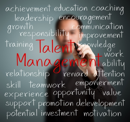 talent management: business man writing talent management concept