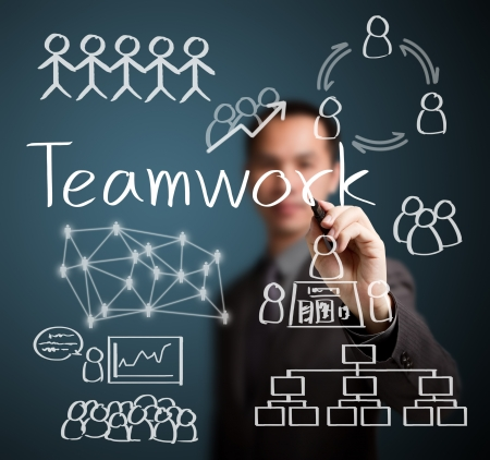 harmonize: business man writing teamwork figure