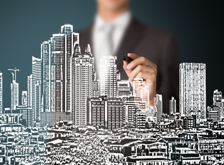 business man drawing urban city building development photo