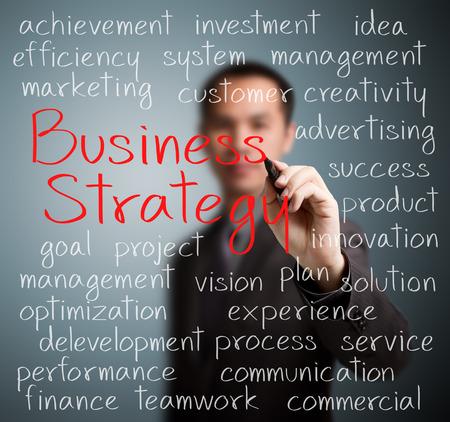 ビジネスマン書くビジネス戦略コンセプト 写真素材