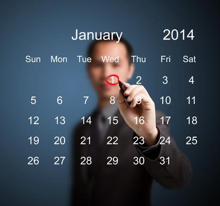 ビジネスの男性マーキング新年 2014年 1 月日カレンダー