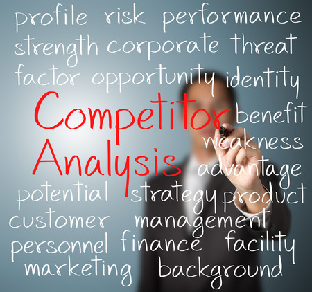 business man writing competitor analysis concept