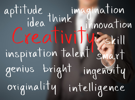 originality: business man writing creativity concept
