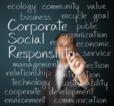 responsibility: business man writing corporate social responsibility   CSR   concept Stock Photo