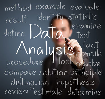 compile: business man writing data analysis concept