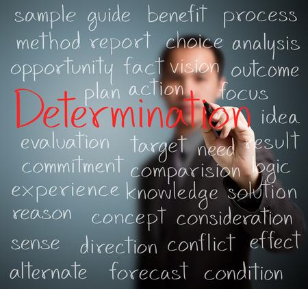 business man writing determination concept photo