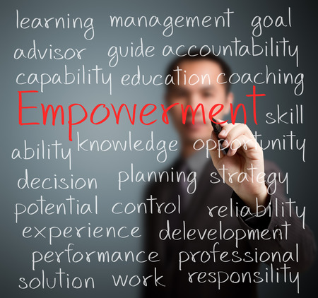 business man writing empowerment concept