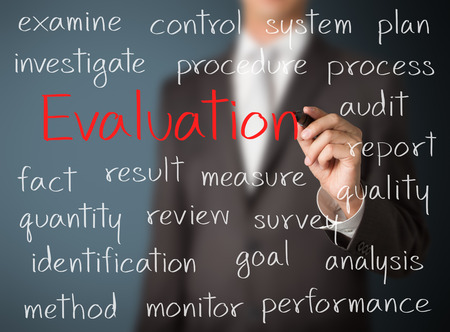 evaluation: business man writing evaluation concept Stock Photo