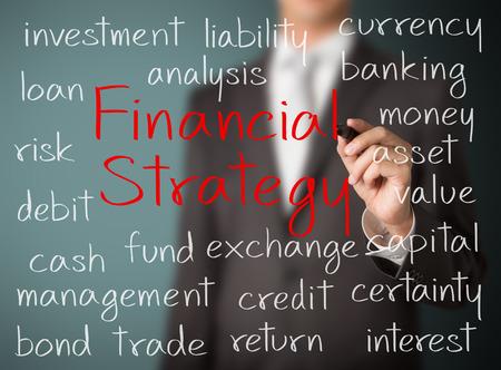 財務戦略の概念を書くビジネス男 写真素材