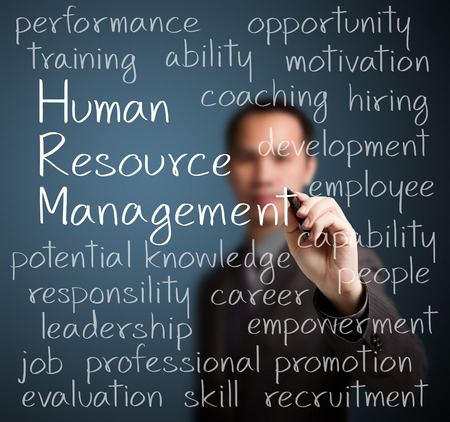 human resource management: business man writing human resource management concept Stock Photo