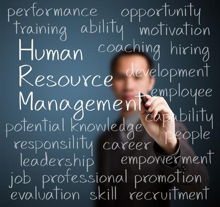 business man writing human resource management concept Stock Photo