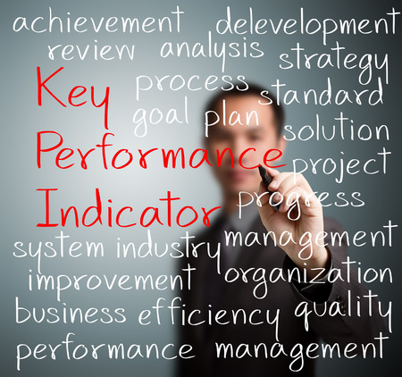 performance improvement: business man writing key performance indicator  kpi  concept