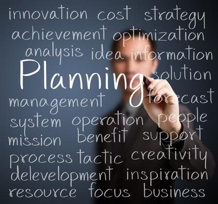 ビジネスの男の計画コンセプトを書き込む