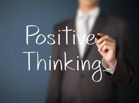 business man writing positive thinking