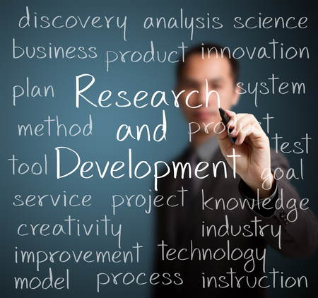 business research: business man writing research and development concept