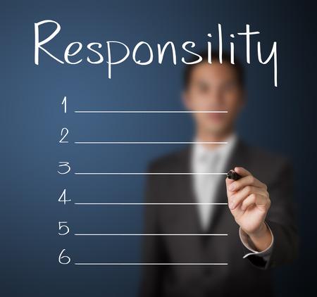 空白の責任のリストを書くビジネス男 写真素材