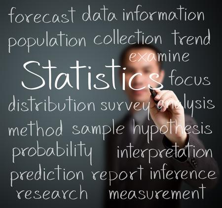 business man writing statistics concept photo