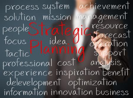 ビジネス男の戦略的な計画のコンセプトの書き込み 写真素材