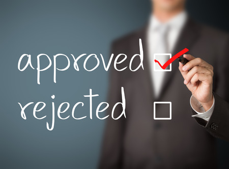 approval: business man selecting approval Stock Photo