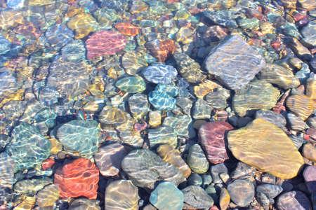 mcdonald: Colorful rocks under the water of McDonald Creek in Glacier National Park, Montana