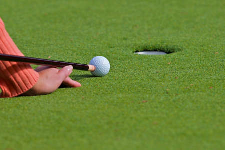 Golf putt with pool cue