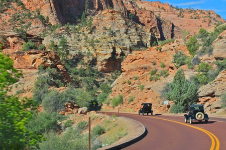 tin: Vintage Antique Cars Driving Through Zion National Park