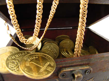 chainlet:  Box of treasure  Gold coins and chain          Stock Photo