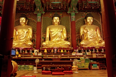 Three golden statues of Buddha in Jogyesa temple (Seoul) photo