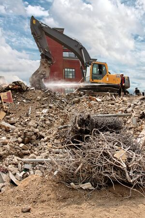 broken house: Demolition of a building; water is used for dust spread prevention Stock Photo