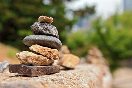 solidity: Small stone cairn near buddhist temple Bogeunsa (Seoul, South Korea) Stock Photo