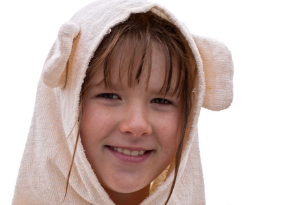 brune: Smiling ten years old girl in a bathrobe isolated on white