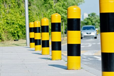 road safety: Yellow and black road safety studs with selected focus in a sunny day