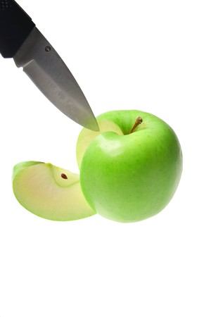 Sliced green apple with knife on white background Stock Photo