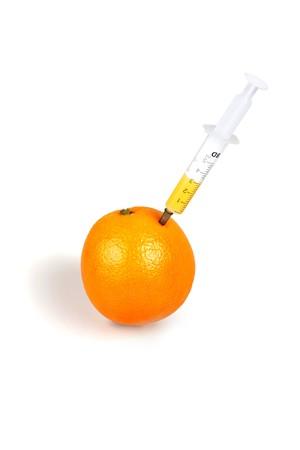 Syringe inserted into an orange