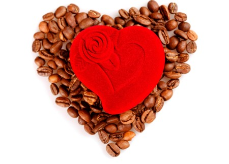 Red heart box on coffee beans