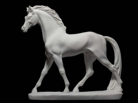 White horse statuette isolated on black Stock Photo - 11746863